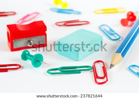 Multicolored office supplies on white desktop close up - stock photo