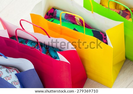 Multicolored paper bags, white background - stock photo