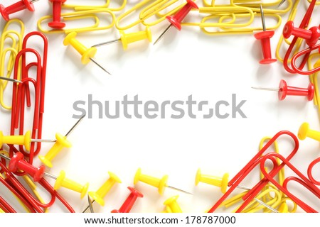 Multicolored paper clips and drawing pins on white background - stock photo