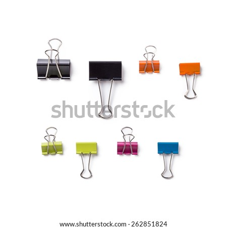 Multicolored paper clips in a pile on a white background. - stock photo