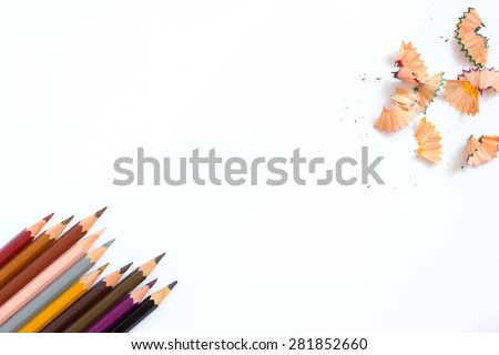 multicolored pencils growing row and  pencil shaves on white background ,Color pencils Background for business presentation - stock photo