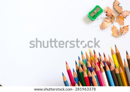 multicolored pencils growing row ,colors sharpener and pencil shaves with shadow on white background ,Color pencils Background for business presentation - stock photo
