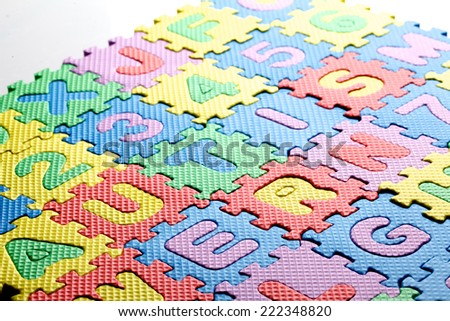 Multicolored plastic toy letters spelling the word Autism - stock photo