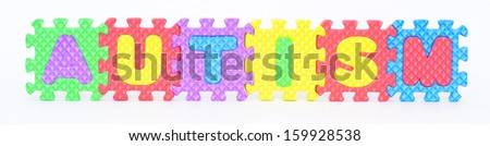 Multicolored plastic toy letters spelling the word Autism isolated on a white background.  - stock photo