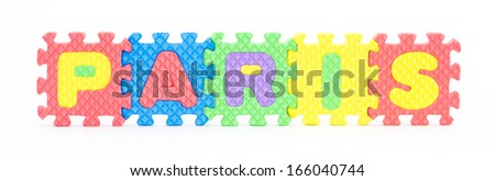 Multicolored plastic toy letters spelling the word Paris capital of France isolated on a white background.  - stock photo