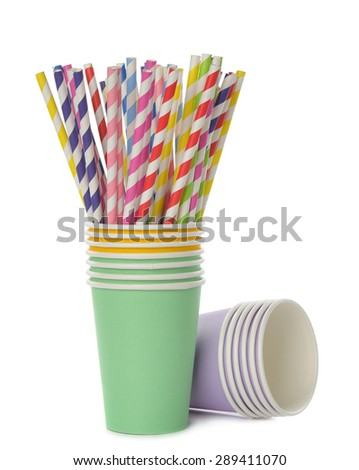 Multicolored retro straws in a paper cup, isolated on white background - stock photo