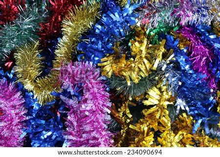 Multicolored shiny Christmas garland - stock photo