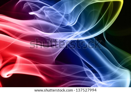 Multicolored smoke in black background - stock photo