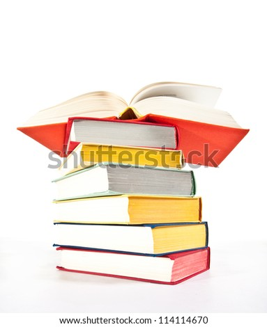 Multicolored stacked books on white background