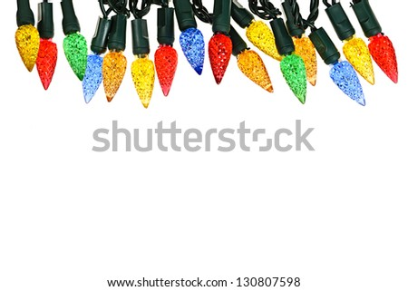 Multicolored string of Christmas lights isolated on white background - stock photo