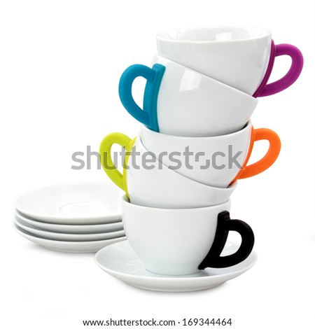 Multicolored tea or coffee cups isolated on white background - stock photo