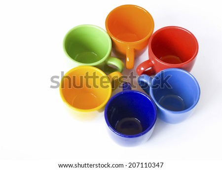 Multicolored teacups isolated on the white background