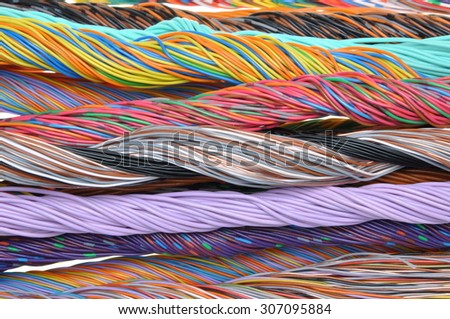 Multicolored telecommunication and computer cables  - stock photo