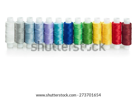 multicolored threads isolated on a white background - stock photo