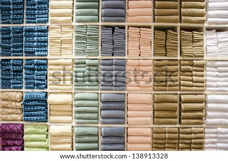 multicolored towels on the shelves - stock photo