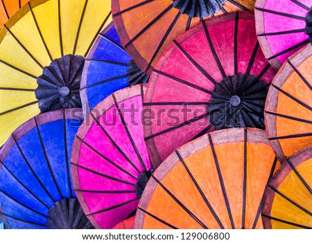 Multicolored umbrellas at night market in Luang Prabang - Laos Pdr - Vintage retro background representing south east asia cultures - stock photo