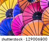 Multicolored Umbrellas at Night Market - South East Asia - stock photo