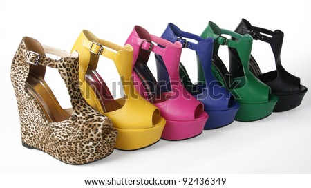 Multicolored wedges shoes on a white background - stock photo
