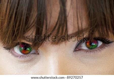 Multicolored woman eyes macro shot - stock photo