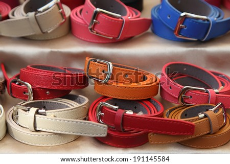 Multicolored women's belts - stock photo