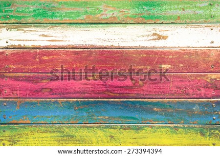Multicolored wood background and alternative construction material - Texture on wooden table in modern fashion restaurant - Retro seamless backdrop pattern - Soft vintage desaturated filtered look - stock photo