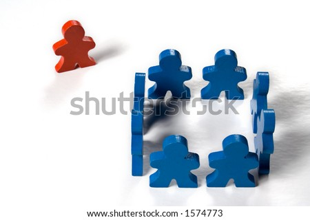 Multicolored wooden people illustrating a business concept - thinking outside the box. - stock photo