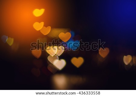 Multicolour bokeh Heart shape ,defocused bokeh lights as background - stock photo