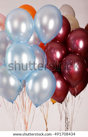 Multicoloured air balloons on isolated studio background