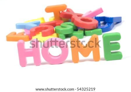 multicoloured bright plastic  HOME on white background - stock photo