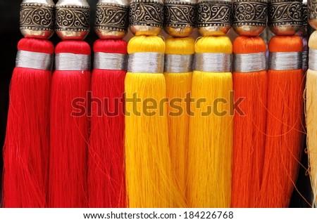 Multicoloured decorative brush for curtains - stock photo