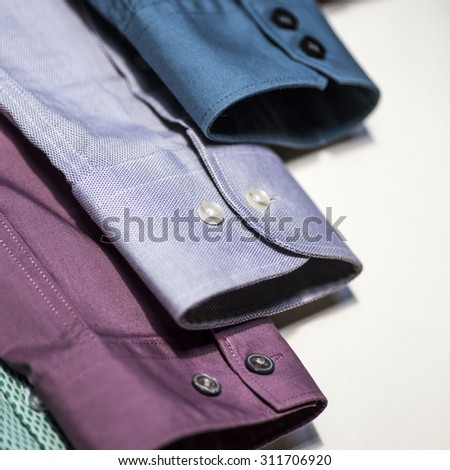 Multicoloured men's shirts - stock photo