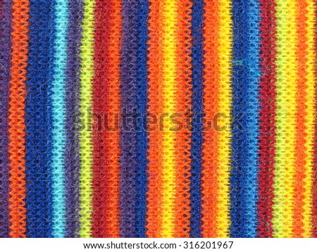Multicoloured striped fabric texture useful as a background