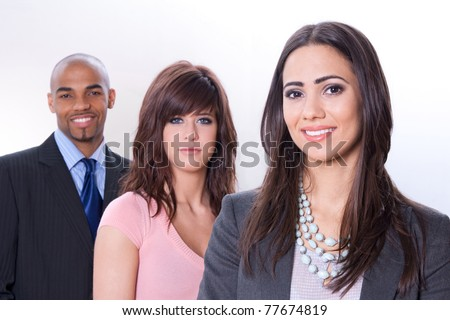Multicultural business team, three smiling young people.