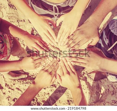 Multicultural children's hands in a circle. Instagram effect - stock photo