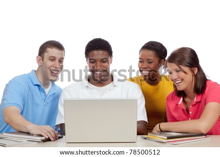 Multicultural College students/friends, male and female, gathered around a computer - stock photo