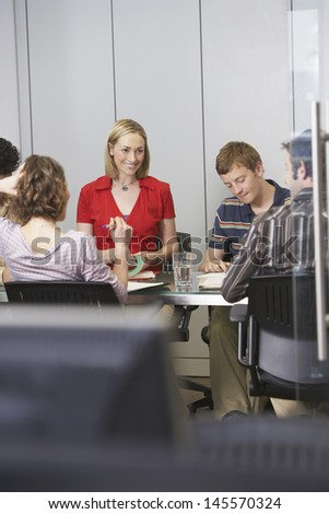Multiethnic business executives sitting around conference table