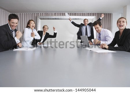 Multiethnic business people enjoying success in conference room - stock photo