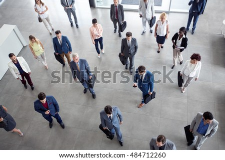 multiethnic business people in the suit going on business meeting in the company