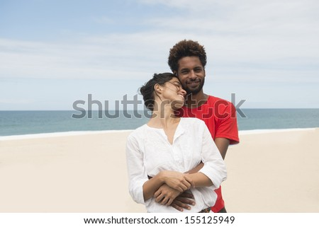 Multiethnic couple on the beach in love