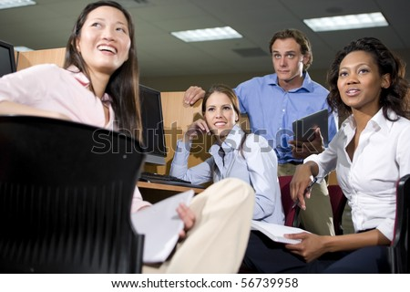Multiethnic group of college students studying together - stock photo