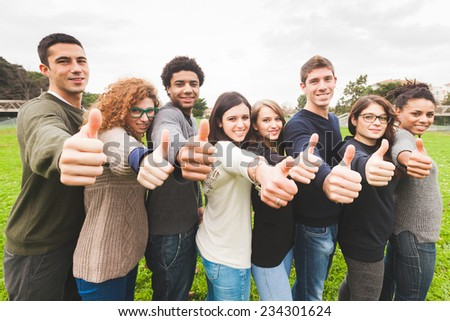 Multiethnic Group of Friends with Thumbs Up - stock photo