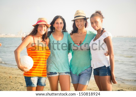 Multiethnic Group of Girls at Beach - stock photo