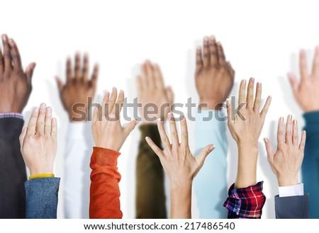 Multiethnic Group of Hands Raised - stock photo