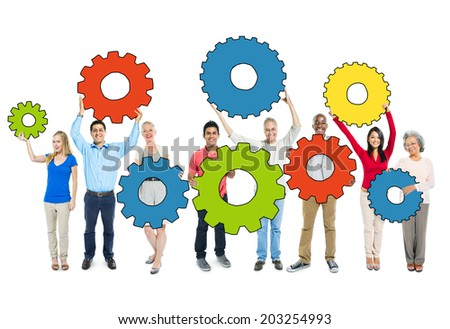 Multiethnic Group of People Holding Gears
