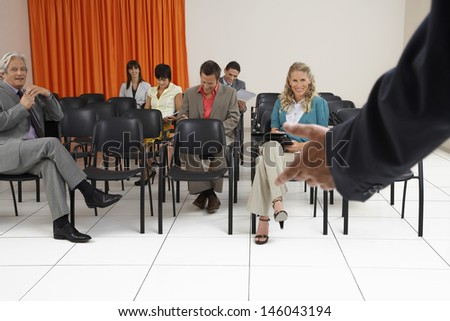 Multiethnic people listening to a seminar in conference room - stock photo