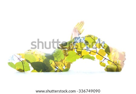 Multiexposure portrait of woman performing yoga asana, combined with photograph of a tree - stock photo