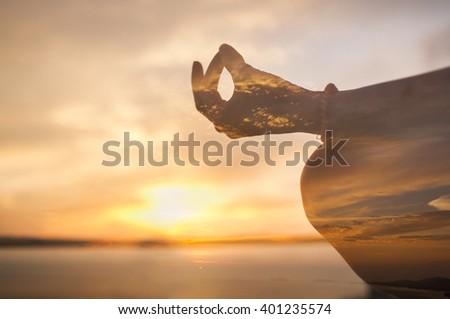 multiexposure.serenity and yoga practicing at sunset, meditation - stock photo