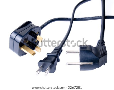 Multifarious international electrical cords on white - stock photo