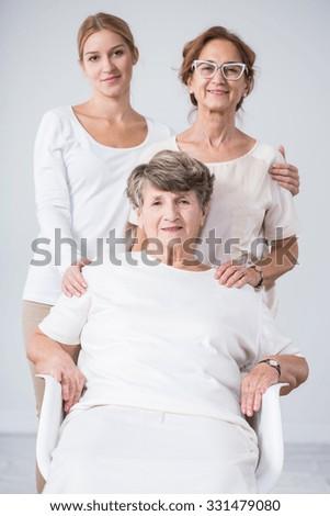 Multigenaration portrait - senior woman, daughter and granddaughter - stock photo
