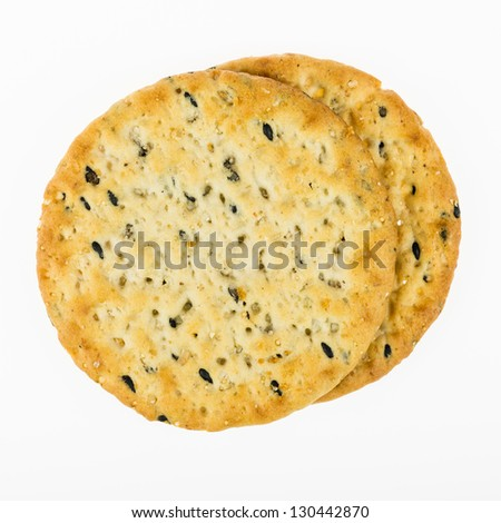 Multigrain crackers - closeup isolated on white background - stock photo